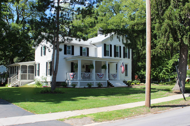 white-house-black-shutters-porch-east-aurora-NY
