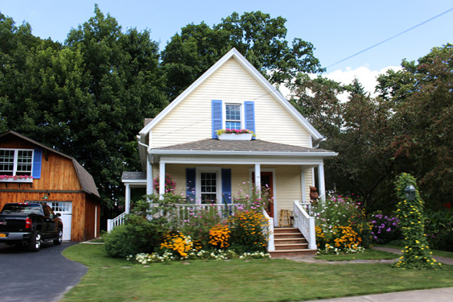 yellow-house-blue-shutters-east-aurora-NY